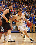 SIOUX FALLS, SD - MARCH 9:  Nate Wolters #3 from South Dakota State University tries to drive past Sean Esposito #20 from IUPUI in the first half of their game Saturday evening at the 2013 Summit League Basketball Championship. (Photo by Dave Eggen/Inertia)