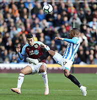 Huddersfield Town's Rajiv van La Parra clears under pressure from Burnley's Matthew Lowton<br /> <br /> Photographer Rich Linley/CameraSport<br /> <br /> The Premier League - Burnley v Huddersfield Town - Saturday 6th October 2018 - Turf Moor - Burnley<br /> <br /> World Copyright &copy; 2018 CameraSport. All rights reserved. 43 Linden Ave. Countesthorpe. Leicester. England. LE8 5PG - Tel: +44 (0) 116 277 4147 - admin@camerasport.com - www.camerasport.com