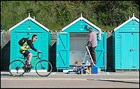 BNPS.co.uk (01202 558833)<br /> Pic: PhilYeomans/BNPS<br /> <br /> Freshening up the beach huts.<br /> <br /> Holidaymakers make the most of the first hot weekend of the year on Bmthn beach today.