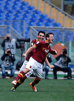 Calcio, Serie A: Roma-Genoa. Roma, stadio Olimpico, 12 gennaio 2014.<br /> AS Roma midfielder Alessandro Florenzi, right, celebrates with teammate Nicolas Burdisso, of Argentina, after scoring during the Italian Serie A football match between AS Roma and Genoa, at Rome's Olympic stadium, 12 January 2014. <br /> UPDATE IMAGES PRESS/Isabella Bonotto