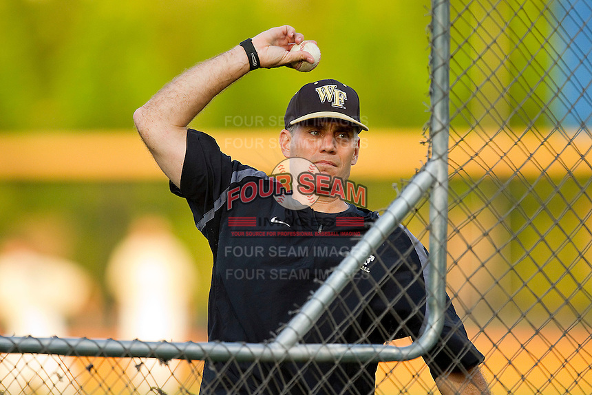 Wake Forest Demon Deacons head coach Tom Walter throws batting practice during fall practice at Wake Forest Baseball Park on October 8, 2011 in Winston-Salem, North Carolina.   (Brian Westerholt / Four Seam Images)