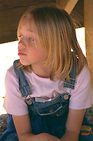 Pensive girl age 7 at Youth Express confidence course.  Camp Ripley  Minnesota USA