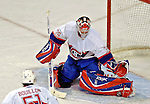 9 December 2006: Montreal Canadiens goaltender Cristobal Huet (39) of France makes a save against the Buffalo Sabres at the Bell Centre in Montreal, Canada. The Sabres defeated the Canadiens 3-2 in a shootout, taking their third contest in the month of December. Mandatory Photo credit: Ed Wolfstein Photo<br />  *** Editorial Sales through Icon Sports Media *** www.iconsportsmedia.com