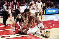 College Park, MD - March 25, 2019: Maryland Terrapins guard Channise Lewis (3) is mobbed by her teammates after scoring a layup as time expires in the first half during second round game of NCAAW Tournament between UCLA and Maryland at Xfinity Center in College Park, MD. UCLA advanced to the Sweet 16 defeating Maryland 85-80.(Photo by Phil Peters/Media Images International)