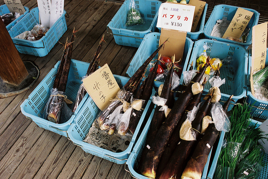 Bamboo shoots and early summer vegetables for sale at a farmer's market in the mountains of Japan.