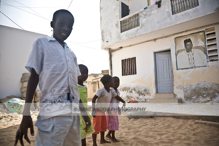 Children in Yoff, a fishing village 30 minutes from Senegal's capital city of Dakar, walk by a neighbor's home.