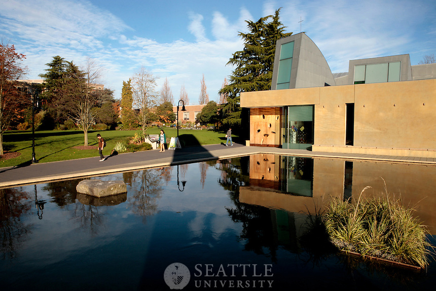 11042010- Students walk by the Chapel of St. Ignatius at Seattle University on an early Fall morning .