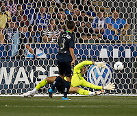 Chris Wondolowski (8) of the MLS All-Stars scores past Henrique Hilario (40) of Chelsea during the game at PPL Park in Chester, PA.  The MLS All-Stars defeated Chelsea, 3-2.