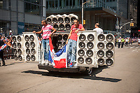 "A ""boombox"" car in the Dominican Day Parade in New York on Sixth Avenue on Sunday, August 11, 2013.  Politicians, flags and cultural pride were on display at the annual event.  (© Richard B. Levine)"