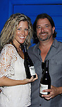 """General Hospital Laura Wright """"Carly"""" poses with her husband John Wright and hold Standing Sun Wines at a Wine Tasting for Standing Sun Wines on August 11, 2012 at MaGooby's Joke House in Timonium, Maryland. The fans got a chance to takes all the various wines, a Q&A, photos, autographs. L(Photo by Sue Coflin/Max Photos)"""