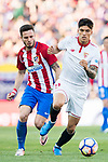 Carlos Joaquin Correa (r) of Sevilla FC battles for the ball with Saul Niguez Esclapez of Atletico de Madrid during their La Liga match between Atletico de Madrid and Sevilla FC at the Estadio Vicente Calderon on 19 March 2017 in Madrid, Spain. Photo by Diego Gonzalez Souto / Power Sport Images