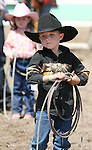 Jackie Sceirine gets ready to compete in the Pee-Wee Dummy Roping event at the Fallon Junior Rodeo.  Photo by Tom Smedes.
