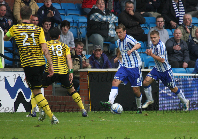 James Fowler running at Ki Sung Yeung as Alex Pursehouse tries to overlap watched by Charlie Mulgrew in the Kilmarnock v Celtic Clydesdale Bank Scottish Premier League match played at Rugby Park, Kilmarnock on 1.10.11