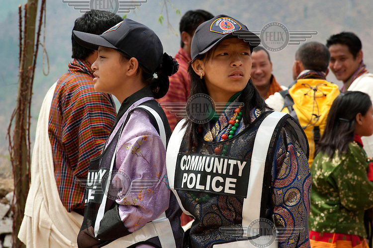 Young community police officers patrolling at the Paro Tsechus Festival as part of their training.