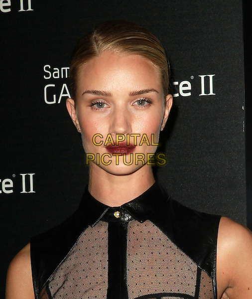 Rosie Huntington-Whiteley.Samsung Mobile Launch Party For The New Samsung Galaxy Note II Held At Private Residence, Beverly Hills, California, USA, 25th October 2012..portrait headshot red stained lips lipstick hair up make-up beauty black beige lace print sheer mesh sleeveless high neck  no bra braless polka dot see thru through  shirt collar .CAP/ADM/KB.©Kevan Brooks/AdMedia/Capital Pictures.