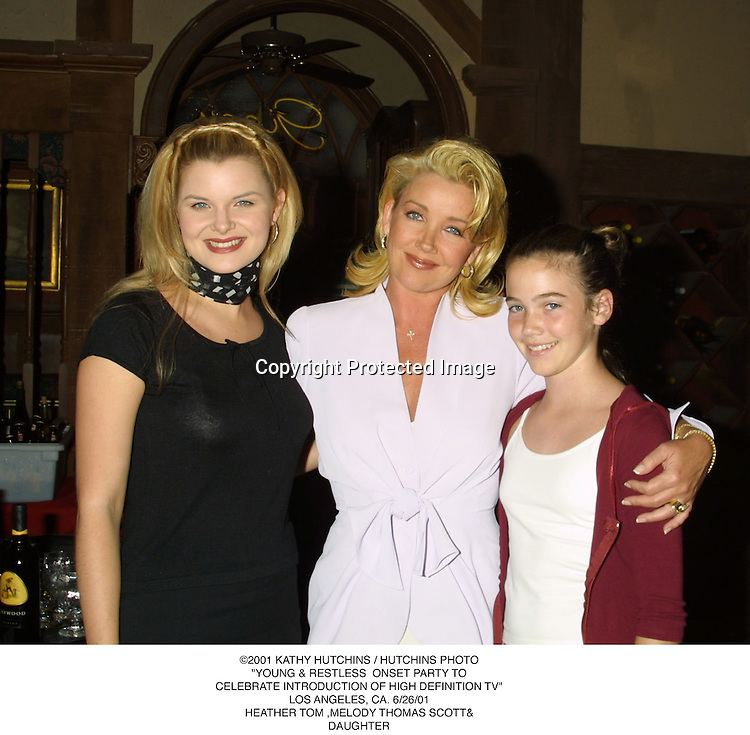 "©2001 KATHY HUTCHINS / HUTCHINS PHOTO.""YOUNG & RESTLESS  ONSET PARTY TO.CELEBRATE INTRODUCTION OF HIGH DEFINITION TV"".LOS ANGELES, CA. 6/26/01.HEATHER TOM,.MELODY THOMAS SCOTT& DAUGHTER"