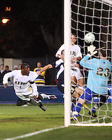 Kofi Sarkodie #8 of the University of Akron beats Chris Blais #23 of the University of Michigan to score the winning goal during the 2010 College Cup semi-final at Harder Stadium, on December 10 2010, in Santa Barbara, California.Akron won 2-1.