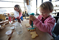 NWA Democrat-Gazette/ANDY SHUPE<br /> Kirksey Miner, 4, (right) of West Fork and friend, Nico Heitz, 6, of Fayetteville decorate Valentine's Day cookies Friday, Feb. 8, 2019, during the Cookie Extravaganza at Southern Food Company in Fayetteville. Participants received a dozen sugar cookies, icing and toppings.
