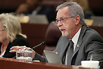 Nevada Assemblyman Glenn Trowbridge, R-Las Vegas, works in committee at the Legislative Building in Carson City, Nev., on Wednesday, March 18, 2015. <br /> Photo by Cathleen Allison