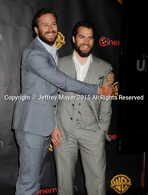 LAS VEGAS, CA - APRIL 21: Actors Armie Hammer (L) and Henry Cavill arrive at Warner Bros. Pictures Invites You to ?The Big Picture at The Colosseum at Caesars Palace during CinemaCon, the official convention of the National Association of Theatre Owners, on April 21, 2015 in Las Vegas, Nevada.