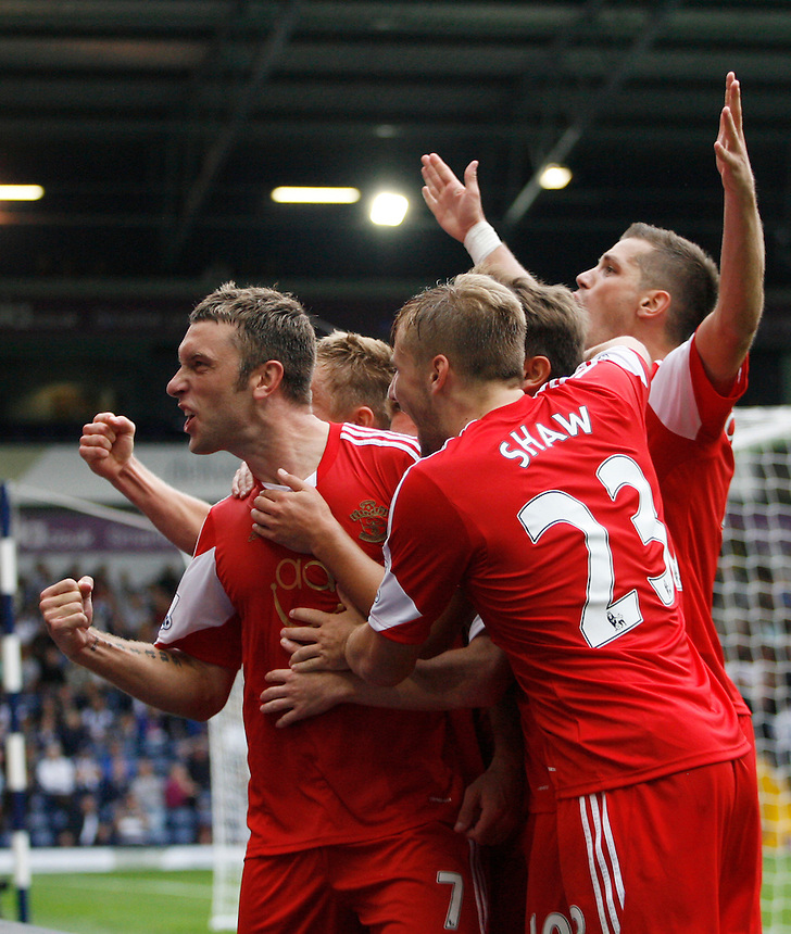 Southampton's Rickie Lambert (L) celebrates scoring his sides first goal <br /> <br />  (Photo by Jack Phillips/CameraSport) <br /> <br /> Football - Barclays Premiership - West Bromwich Albion v Southampton - Saturday 17th August 2013 - The Hawthorns - West Bromwich<br /> <br /> &copy; CameraSport - 43 Linden Ave. Countesthorpe. Leicester. England. LE8 5PG - Tel: +44 (0) 116 277 4147 - admin@camerasport.com - www.camerasport.com