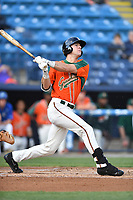Greensboro Grasshoppers first baseman Colby Lusignan (40) swings at a pitch during a game against the Asheville Tourists at McCormick Field on April 27, 2017 in Asheville, North Carolina. The Tourists defeated the Grasshoppers 8-5. (Tony Farlow/Four Seam Images)