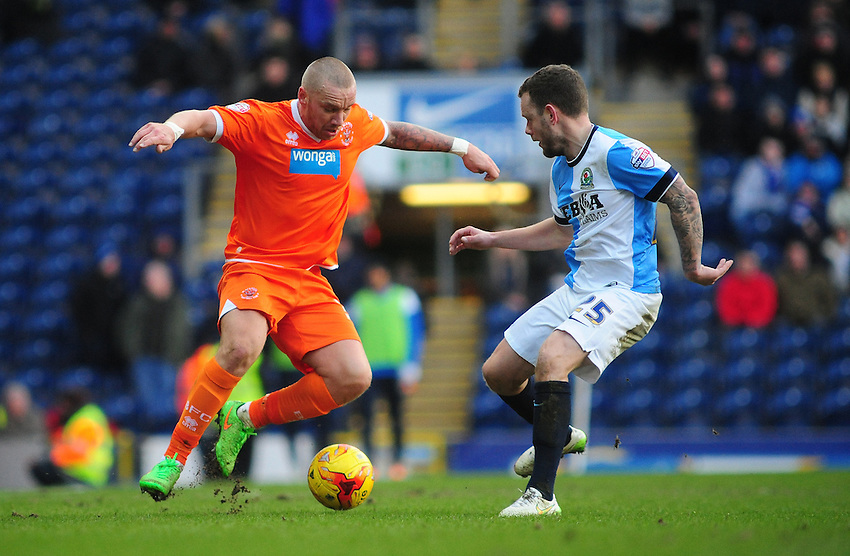 Blackpool's Jamie O'Hara vies for possession with Blackburn Rovers' Jay Spearing<br /> <br /> Photographer Chris Vaughan/CameraSport<br /> <br /> Football - The Football League Sky Bet Championship - Blackburn Rovers v Blackpool - Saturday 21st February 2015 - Ewood Park - Blackburn<br /> <br /> &copy; CameraSport - 43 Linden Ave. Countesthorpe. Leicester. England. LE8 5PG - Tel: +44 (0) 116 277 4147 - admin@camerasport.com - www.camerasport.com