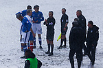Referee Sebastian Stockridge explains to the players that play is suspended because the touchlines are obscured. Oldham v Portsmouth League 1