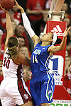 VERMILLION, SD, APRIL 2:  Margaret McCloud #30 from the University of South Dakota has her shot blocked by Whitney Knight #14 from Florida Gulf Coast during the WNIT Championship game Saturday afternoon at the Dakota Dome in Vermillion, S.D. (Photo by Dave Eggen/Inertia)
