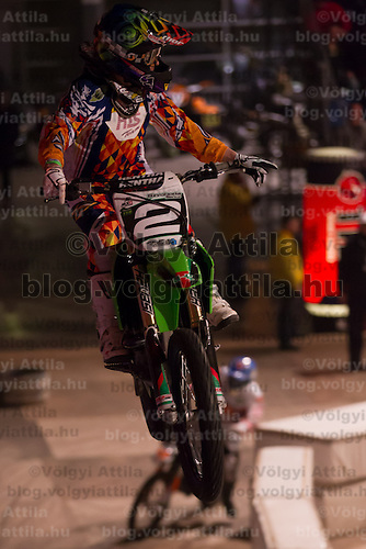 Bence Szvoboda from Hungary competes during the Indoor Super Moto-Cross race in Budapest, Hungary on February 4, 2012. ATTILA VOLGYI
