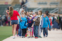 """Local students get to parade around the warning track as part of the """"Reading All-Stars"""" program prior to the South Atlantic League game between the Kannapolis Intimidators and the Asheville Tourists at Kannapolis Intimidators Stadium on May 5, 2017 in Kannapolis, North Carolina.  The Tourists defeated the Intimidators 5-1.  (Brian Westerholt/Four Seam Images)"""