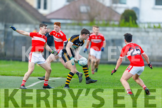 Stacks Sean Quilter about to hand pass as the Dingle backs, Aiden O'Connor and Séan Óg Moran applies the pressure in the Division 1 County Football league play off game in Connolly Park on Sunday.