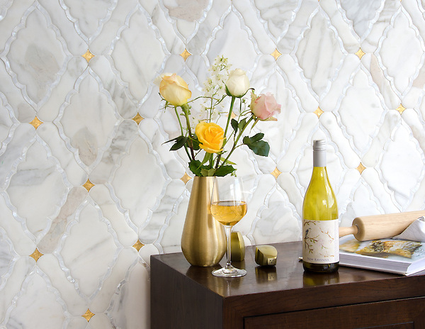 Josephine, a waterjet mosaic shown in Shell, Venetian honed Calacatta and honed 24K Gold Glass, is part of the Aurora&trade; Collection by Sara Baldwin for New Ravenna.<br /> <br /> For pricing samples and design help, click here: http://www.newravenna.com/showrooms/