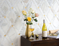 Josephine, a waterjet mosaic shown in Shell, Venetian honed Calacatta and honed 24K Gold Glass, is part of the Aurora&reg; collection by Sara Baldwin for New Ravenna.<br />