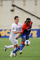 Leonel Saint-Preux (9) of Haiti (HAI) is marked by Sam Cronin (15) of the United States (USA). The United States and Haiti played to a 2-2 tie during a CONCACAF Gold Cup Group B group stage match at Gillette Stadium in Foxborough, MA, on July 11, 2009. .