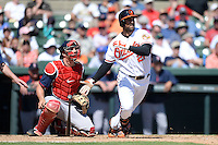 Baltimore Orioles outfielder Nick Markakis (21) at bat in front of catcher Ryan Lavarnway (20) during a spring training game against the Boston Red Sox on March 8, 2014 at Ed Smith Stadium in Sarasota, Florida.  Baltimore defeated Boston 7-3.  (Mike Janes/Four Seam Images)