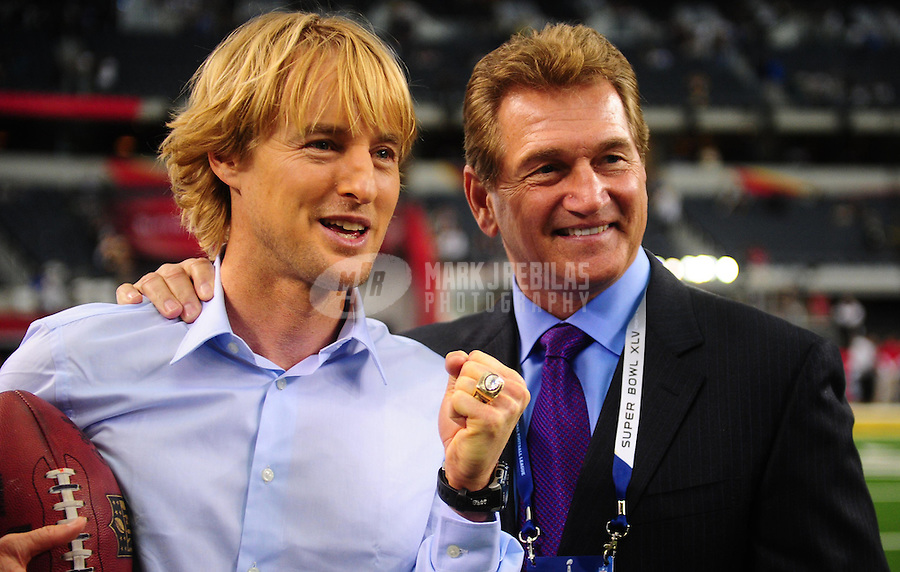Feb 6, 2011; Arlington, TX, USA; Movie actor Owen Wilson (left) poses for a photo with Joe Theismann (right) before Super Bowl XLV between the Green Bay Packers and the Pittsburgh Steelers at Cowboys Stadium.  Mandatory Credit: Mark J. Rebilas-