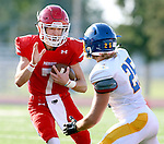 SIOUX FALLS, SD - SEPTEMBER 25: Cole DeBerg #7 from Lincoln looks to make a move against Braiden Nelson #25 form Aberdeen Central in the first quarter of their game Friday night at Howard Wood Field. (Photo by Dave Eggen/Inertia)
