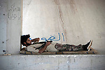 Sco0033837 .  Daily Telegraph..A rebel fighter takes a rest in an underpass at a checkpoint close to Tripoli airport ...Tripoli 28 August 2011. ............Not Getty.Not Reuters.Not AP.Not Reuters.Not PA