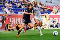 HARRISON, NJ - SEPTEMBER 29: Elizabeth Eddy #19 of Sky Blue FC battles for the ball with Claire Emslie #7 of the Orlando Pride during a game between Orlando Pride and Sky Blue FC at Red Bull Arena on September 29, 2019 in Harrison, New Jersey.