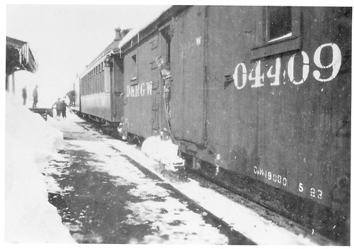 D&amp;RGW passenger train at Crested Butte depot with baggage car, open-vestibule coach and outfit car #04409.<br /> D&amp;RGW  Crested Butte, CO  ca. 1925<br /> See RD030-069 for another photo of #04409.