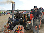 Mickey Brannigan pictured with his steam engine at the Wee County Fair in Dunleer. Photo: www.pressphotos.ie