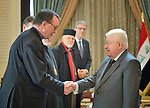Bishop Martin Hermann Hein (left) of the Evangelical Church in Germany greets Iraqi President Fuad Masum on January 22, 2017, during the visit of a high-level ecumenical delegation to Baghdad.