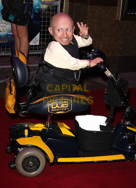 """VERNE TROYER .Attending the UK film premiere of """"The Imaginarium Of Doctor Parnassus"""" at the Empire Leicester Square cinema, London, England, UK, October 6th 2009..full length sitting riding driving hand waving scooter electric pale yellow shirt grey gray waistcoat DUB edition .CAP/ROS.©Steve Ross/Capital Pictures"""