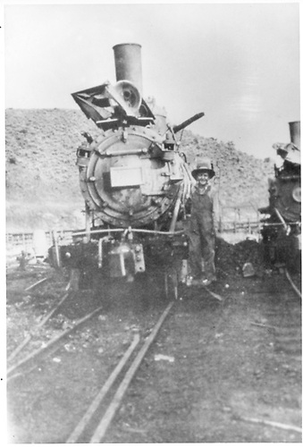 Burned out engine on the sight of the burned roundhouse.  Fire occurred on August 6, 1920.<br /> D&amp;RG  Cimarron, CO  Taken by Walker, Wallace - 8/1920