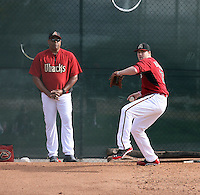 Pitching coach Mike Harkey (L), Archie Bradley (R) of the Arizona Diamondbacks participates in the first day of spring training workouts at Salt River Fields on February 7, 2014 in Scottsdale, Arizona (Bill Mitchell)