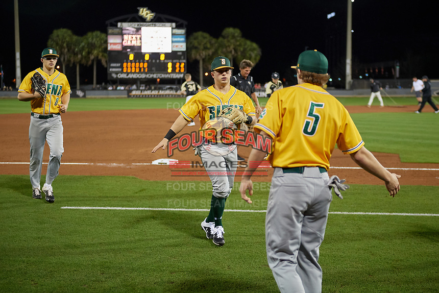 Siena Saints Brendan Conley (1) high fives Davis Zerr (5)  during a game against the UCF Knights on February 14, 2020 at John Euliano Park in Orlando, Florida.  UCF defeated Siena 2-1.  (Mike Janes/Four Seam Images)