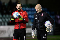 Lincoln City's Josh Vickers, left, and Lincoln City's first team goalkeeping coach Andy Warrington during the pre-match warm-up<br /> <br /> Photographer Chris Vaughan/CameraSport<br /> <br /> The EFL Sky Bet League Two - Lincoln City v Yeovil Town - Friday 8th March 2019 - Sincil Bank - Lincoln<br /> <br /> World Copyright © 2019 CameraSport. All rights reserved. 43 Linden Ave. Countesthorpe. Leicester. England. LE8 5PG - Tel: +44 (0) 116 277 4147 - admin@camerasport.com - www.camerasport.com
