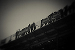 Crowd members watch the rodeo from the top of the bleachers during the Reno Rodeo on Saturday, June 29, 2013 in Reno, Nevada<br /> (Photo by Kevin Clifford)
