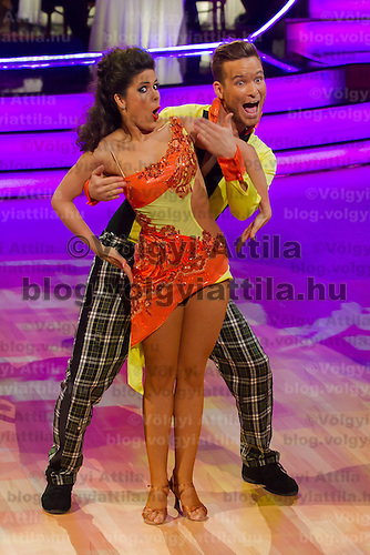 Bence Istenes és Iringo Sudi dance in the live broadcast celebrity dancing talent show Saturday Night Fever by Hungarian television company RTL II in Budapest, Hungary on March 16, 2013. ATTILA VOLGYI